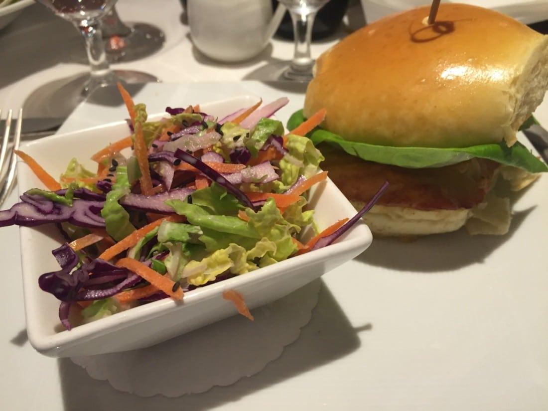 Grilled salmon sandwich on a Brioche bun with coleslaw